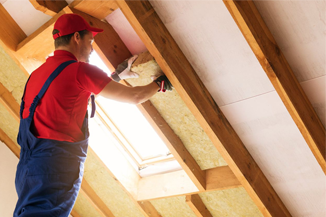 Men putting insulation on ceiling